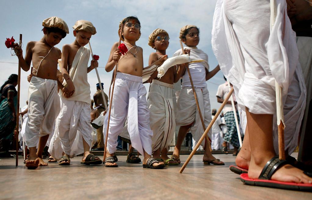 . Indian children dressed as Mahatma Gandhi assemble at an event to mark Gandhi\'s birth anniversary in Chennai, India, Wednesday, Oct. 2, 2013. (AP Photo/ Arun Sankar K)