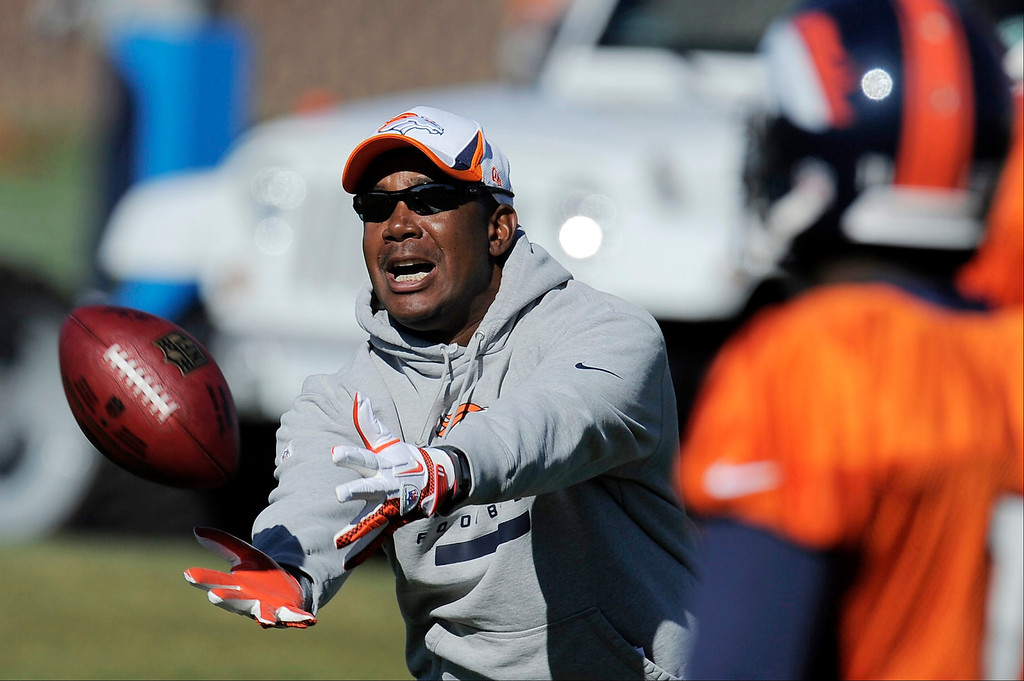 . ENGLEWOOD, CO - OCTOBER 27: Denver Broncos WR coach Tyke Tolbert reaches out for a passduring practice on October 30, 2013 at Dove Valley. (Photo by John Leyba/The Denver Post)