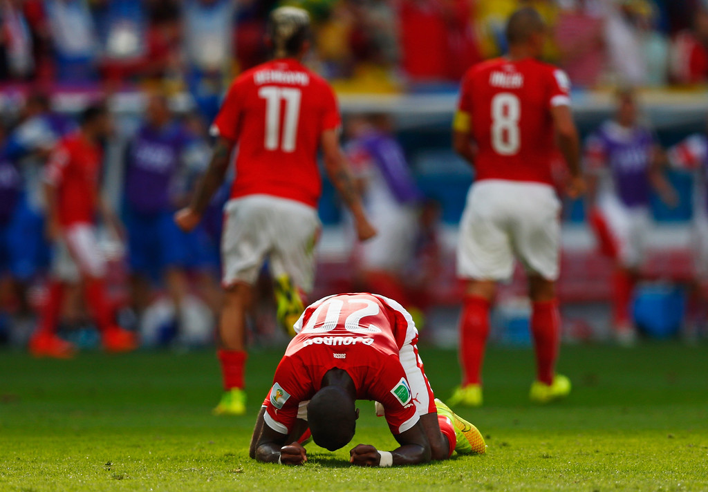 . Johan Djourou of Switzerland celebrates after defeating Ecuador 2-1 during the 2014 FIFA World Cup Brazil Group E match between Switzerland and Ecuador at Estadio Nacional on June 15, 2014 in Brasilia, Brazil.  (Photo by Phil Walter/Getty Images)