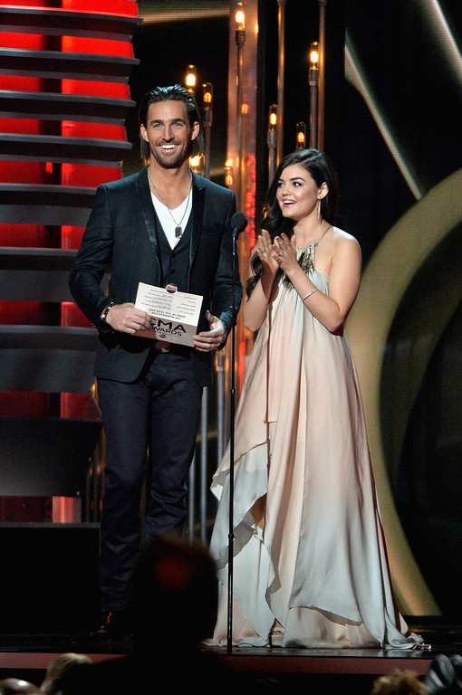 . NASHVILLE, TN - NOVEMBER 06:  Jake Owen and Lucy Hale speak onstage during the 47th annual CMA Awards at the Bridgestone Arena on November 6, 2013 in Nashville, Tennessee.  (Photo by Rick Diamond/Getty Images)