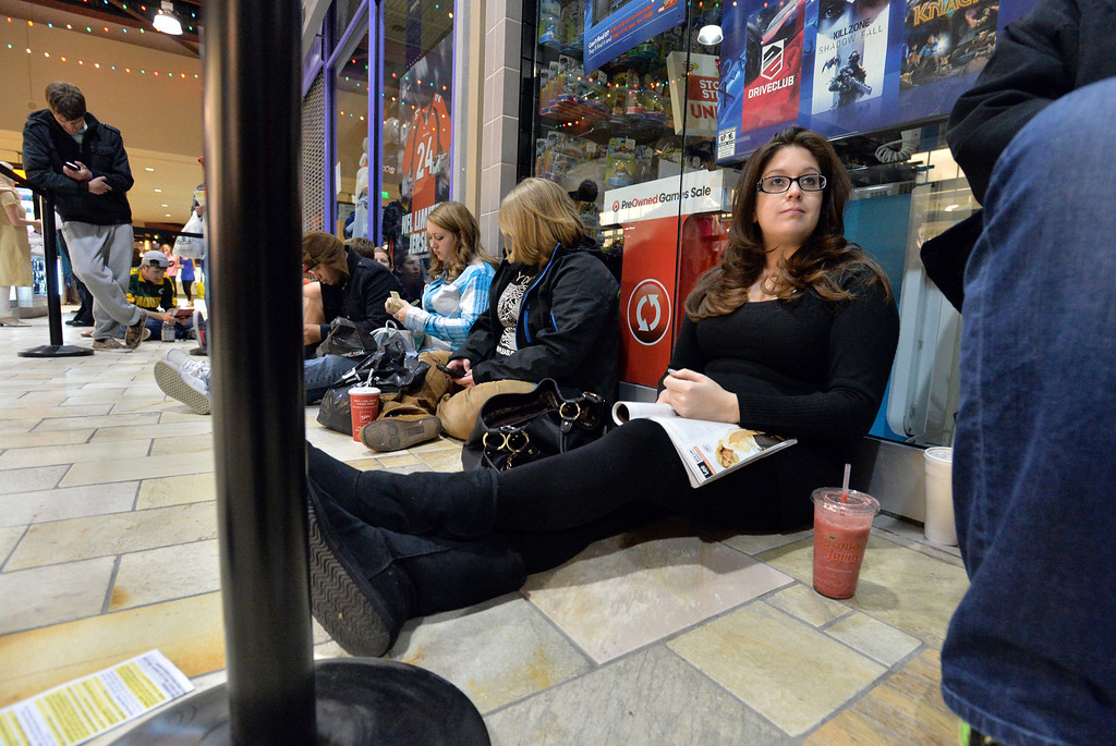 . Melissa Chavez waits for the Game STop store to open at midnight at FlatIron Crossing mall on Thursday,  November 28, 2013. David R. Jennings/Boulder Daily Camera