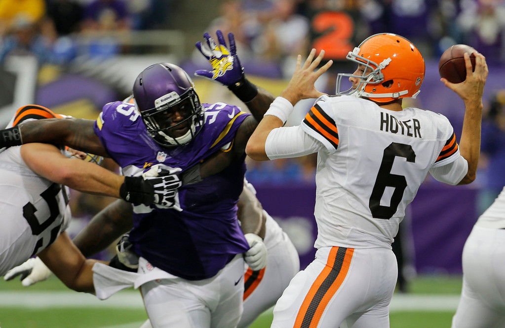 . Cleveland Browns quarterback Brian Hoyer (6) passes the ball while getting pressured by Minnesota Vikings defensive tackle Sharrif Floyd during the second half of an NFL football game Sunday, Sept. 22, 2013, in Minneapolis. (AP Photo/Ann Heisenfelt)