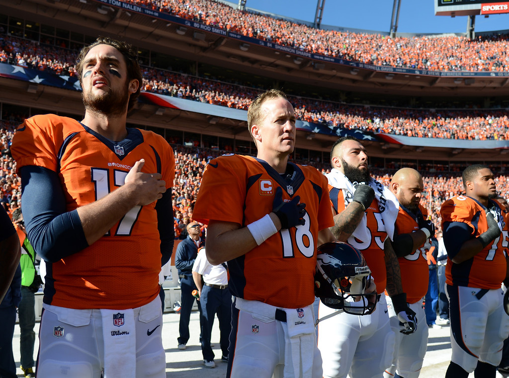 . Denver Broncos quarterback Peyton Manning (18) stands during the National Anthem before the Denver Broncos took on the New England Patriots in the AFC Championship game  at Sports Authority Field at Mile High in Denver on January 19, 2014. (Photo by John Leyba/The Denver Post)