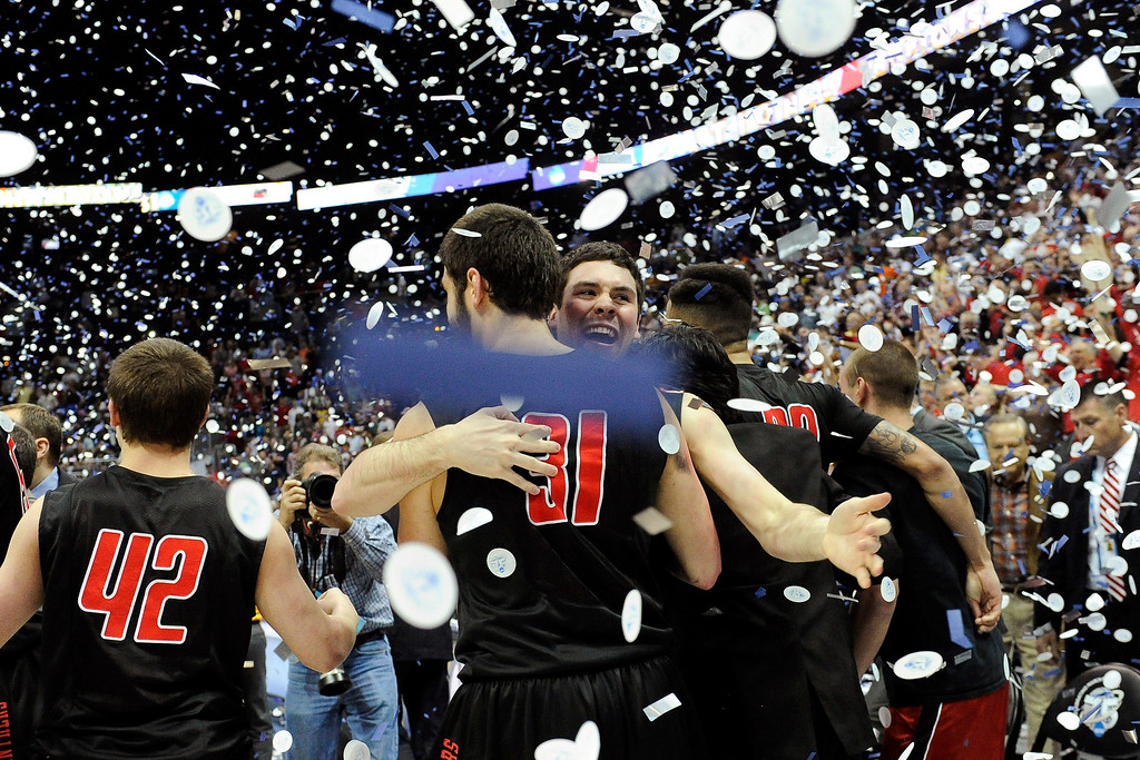 . Drurys\' Teddy Simniok (31) hugs Nick Schelbar as they celebrate their 74-73 win over Metro State in the NCAA Division ll national championship college basketball game, Sunday, April 7, 2013, in Atlanta. (AP Photo/John Amis)