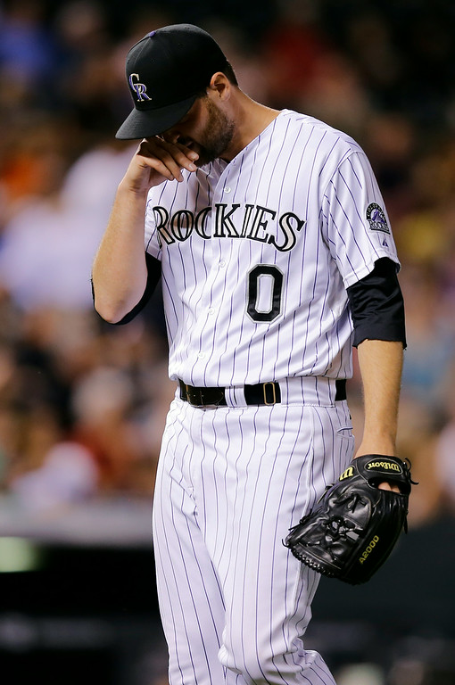 . Colorado Rockies relief pitcher Adam Ottavino reacts after giving up a run to the Cincinnati Reds during the ninth inning of a baseball game Friday, Aug. 15, 2014, in Denver. (AP Photo/Jack Dempsey)