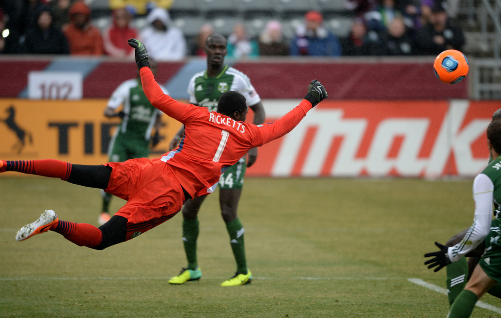 . COMMERCE CITY MARCH 22: Donovan Ricketts of Portland Timbers (1) saves the goal from a shot by Dillon Powers of Colorado Rapids (8) in the 1st half of the game at Dick\'s Sporting Goods Park. Commerce City, Colorado. March 22. 2014. (Photo by Hyoung Chang/The Denver Post)