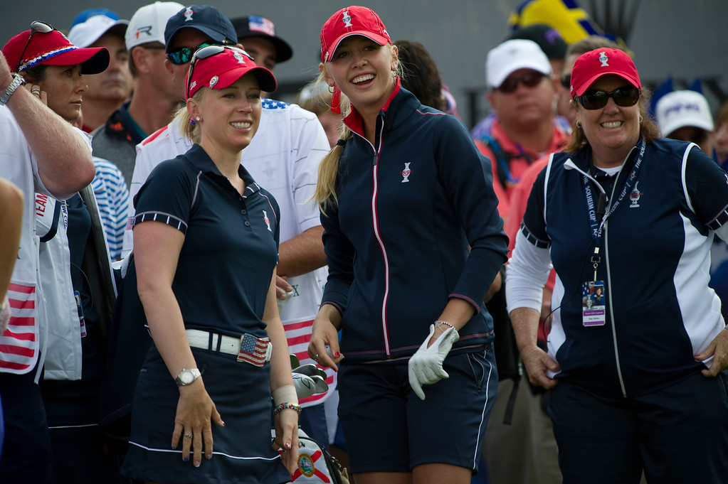 . PARKER, CO - AUGUST 16: Americans Morgan Pressel, left, and Jessica Korda smile at the crowd on the first tee during the first day of the Solheim Cup at Colorado Golf Club, on August 16, 2013.  (Photo By Grant Hindsley/The Denver Post)