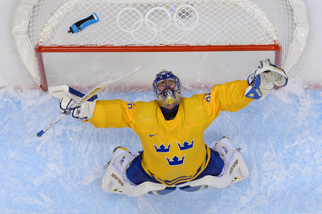 . Sweden\'s goalkeeper Henrik Lundqvist celebrates at the end of the Men\'s Ice Hockey Semifinal match between Sweden and Finland at the Bolshoy Ice Dome during the Sochi Winter Olympics on February 21, 2014. Sweden won 2-1.  ALEXANDER NEMENOV/AFP/Getty Images