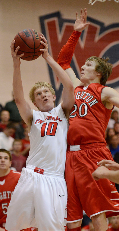 . Brighton\'s Michaell Willis (20) fouls Jake Holtzmann (10) as he goes up for a shot during the first quarter against Chaparral February 27, 2013. (Photo By John Leyba/The Denver Post)
