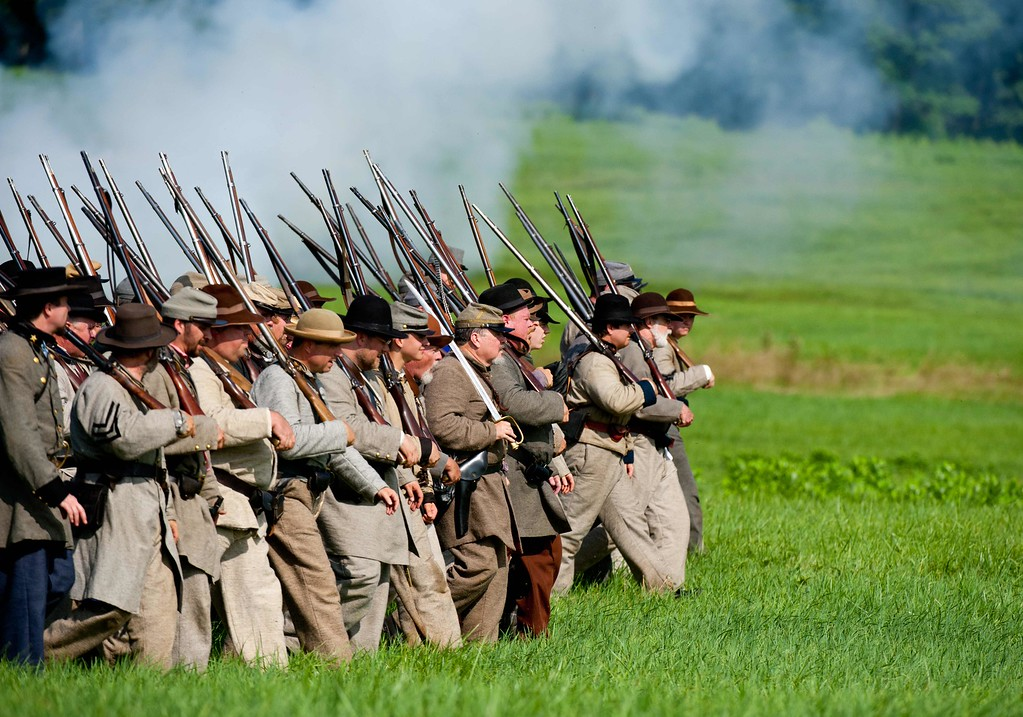 . Confederate troops march into position during a re-enactment of the Battle of Gettysburg on June 28, 2013 at the start of the 150th Gettysburg celebration and re-enactments in Gettysburg, Pennsylvania. Over three days, more than 10,000 re-enactors will pay tribute the major battles that took place in Gettysburg during the 1861-1865 US Civil War. KAREN BLEIER/AFP/Getty Images