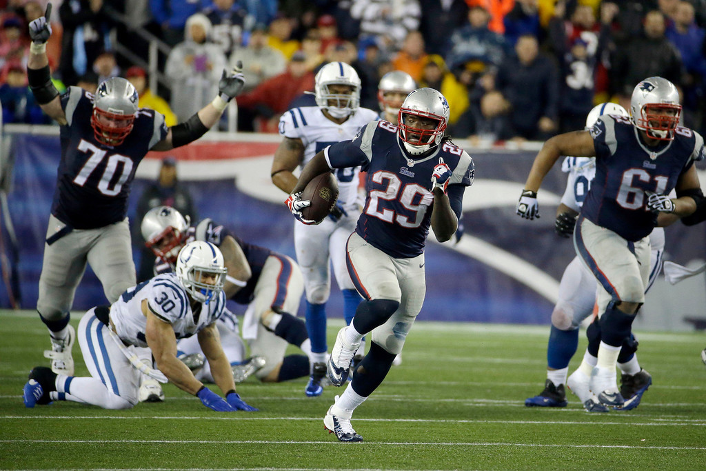 . New England Patriots running back LeGarrette Blount (29) heads downfield for a touchdown during the second half of an AFC divisional NFL playoff football game against the Indianapolis Colts in Foxborough, Mass., Saturday, Jan. 11, 2014. (AP Photo/Matt Slocum)