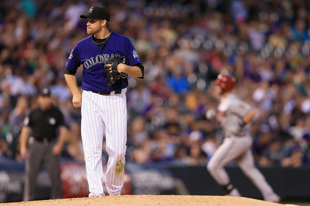 . DENVER, CO - SEPTEMBER 21:  Starting pitcher Collin McHugh #43 of the Colorado Rockies returns to the mound as Matt Davidson #24 of the Arizona Diamondbacks rounds the bases on his three run home run to give the Diamondbacks a 5-0 lead in the third inning at Coors Field on September 21, 2013 in Denver, Colorado.  (Photo by Doug Pensinger/Getty Images)