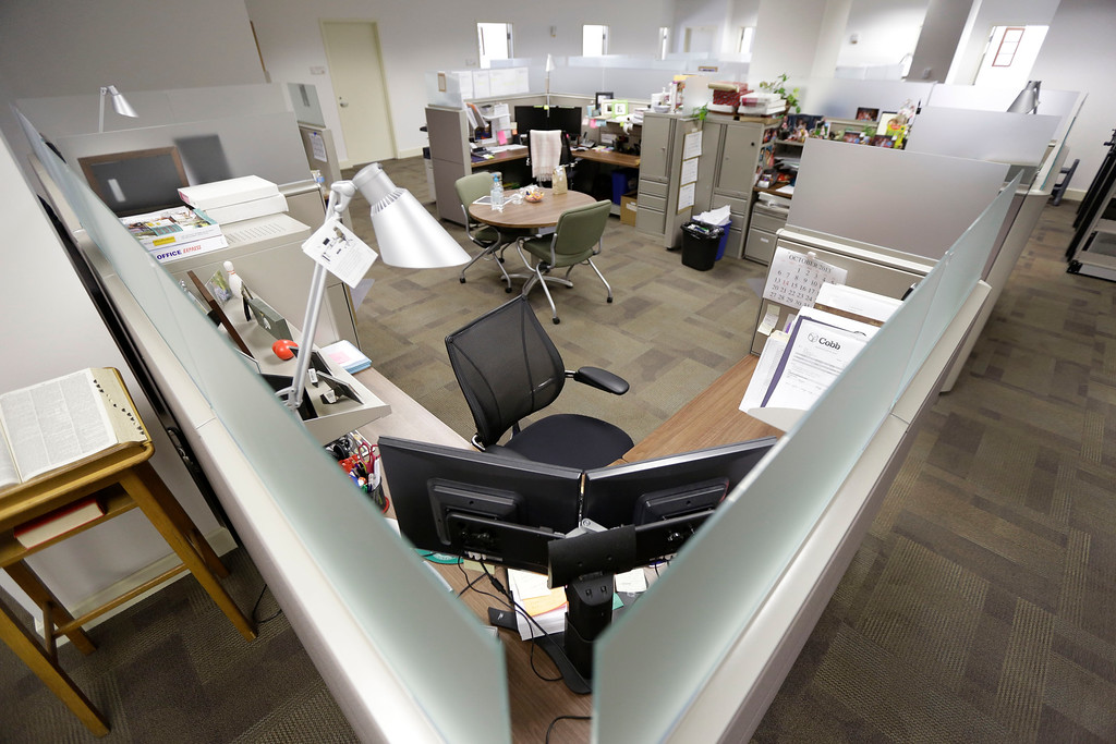 . Chairs and cubicles are empty  at the U.S. Army Garrison Ft. Lee Management Services budget office in Petersburg, Va., Wednesday, Oct. 2, 2013.  (AP Photo/Steve Helber)
