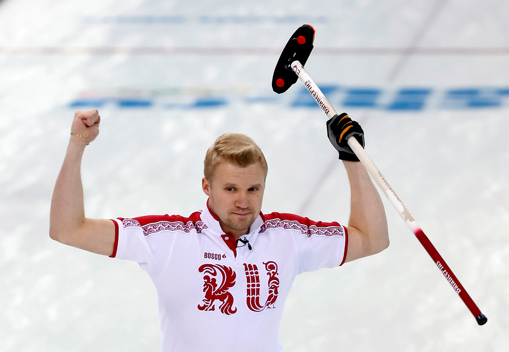 . Russiaís skip Alexei Stukalskiy celebrates his win over the United States in men\'s curling competition against at the 2014 Winter Olympics, Monday, Feb. 17, 2014, in Sochi, Russia. (AP Photo/Robert F. Bukaty)