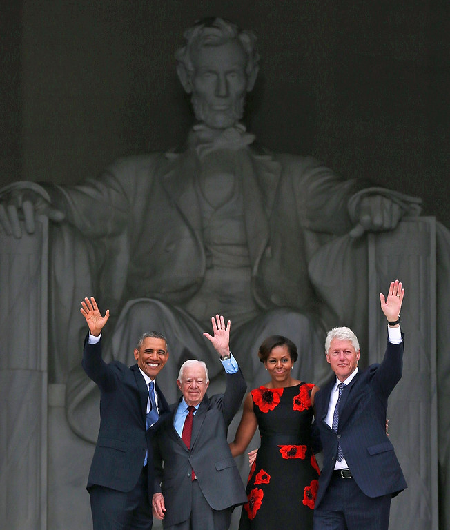 ". President Barack Obama (L) stands with his wife Michelle Obama (2nd-R) and former presidents Jimmy Carter (2nd-L) and Bill Clinton (R) during the ceremony to commemorate the 50th anniversary of the March on Washington for Jobs and Freedom August 28, 2013 in Washington, DC. It was 50 years ago today that Martin Luther King, Jr. delivered his ""I Have A Dream Speech\"" on the steps of the Lincoln Memorial. (Photo by Mark Wilson/Getty Images)"