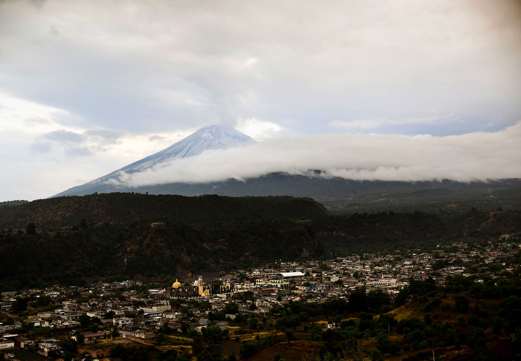 . View of Santiago Xalitxintla community with the Popocatepetl Volcano on the background, in Puebla, Mexico, on May 13, 2013. According to a report by the National Center of Prevention of Disasters (CENAPRED) the yellow alert phase three is still in force. Ronaldo Schemidt/AFP/Getty Images
