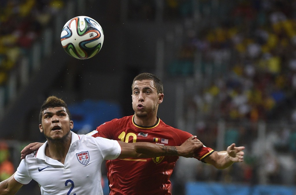 . US defender DeAndre Yedlin (L) vies with Belgium\'s forward Eden Hazard during a Round of 16 football match between Belgium and USA at Fonte Nova Arena in Salvador during the 2014 FIFA World Cup on July 1, 2014. AFP PHOTO / MARTIN  BUREAU/AFP/Getty Images