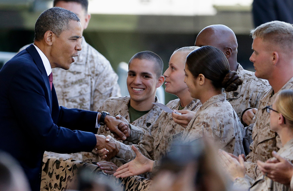 . President Barack Obama, left, greets Marines and their families before a speech Wednesday, Aug. 7, 2013, in Camp Pendleton, Calif.  The visit to the Marine Corps base is Obama\'s final stop on a two-day West Coast trip that included the rollout of his principles for overhauling the nation\'s mortgage finance industry. (AP Photo/Gregory Bull)