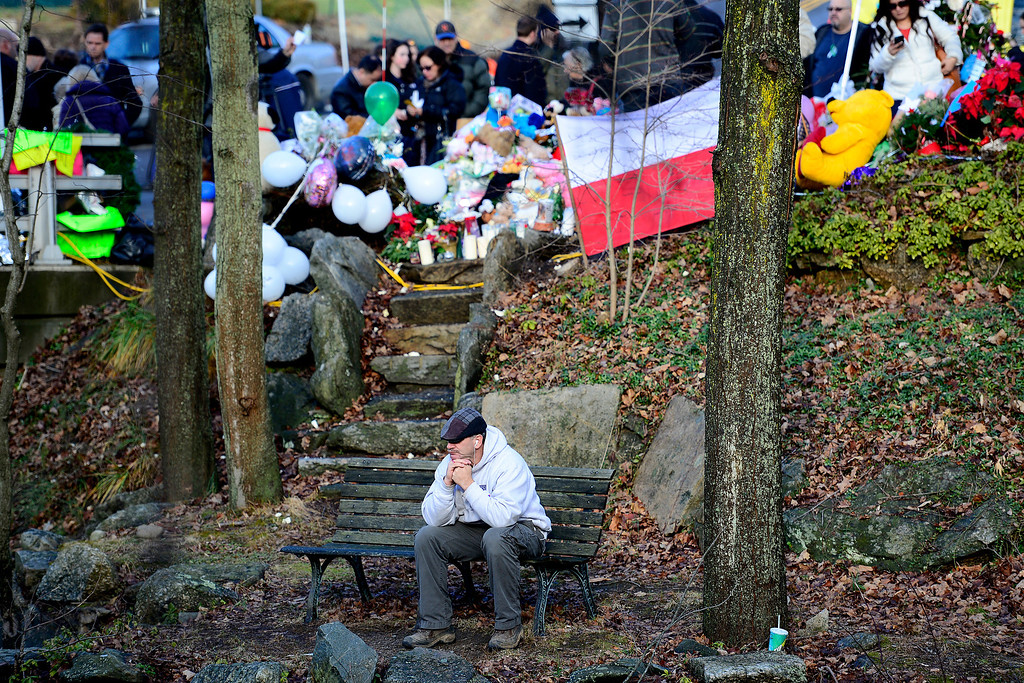 . James Giampaolo, of Torrington, Conn., takes a moment near the water as and fellow community members remember the victims of the Sandy Hook school shooting in Newtown, Connecticut on Tuesday, December 18, 2012. AAron Ontiveroz, The Denver Post