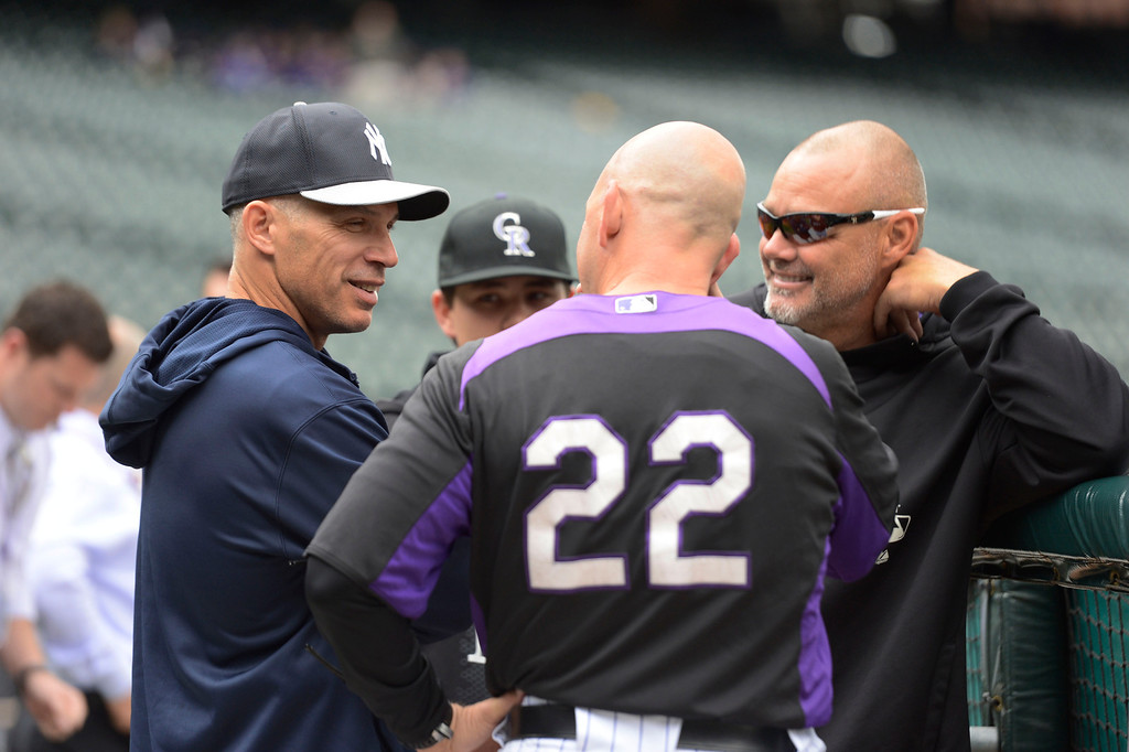 . DENVER, CO. - MAY 07: New York Yankees manager talks with Walt Weiss (22) of the Colorado Rockies and Dante Bichette during batting practice  May 7, 2013 at Coors Field. (Photo By John Leyba/The Denver Post)