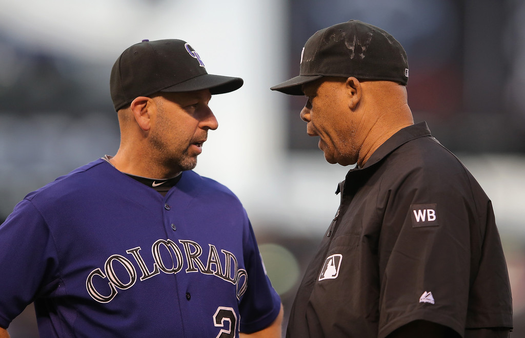 . Manager Walt Weiss #22 of the Colorado Rockies challenges a call by umpire Kerwin Danley on a play at first base against the Texas Rangers in the second inning during Interleague play at Coors Field on May 5, 2014 in Denver, Colorado. Danley called DJ LeMahieu #9 of the Colorado Rockies out and the call was overturned after video replay.  (Photo by Doug Pensinger/Getty Images)