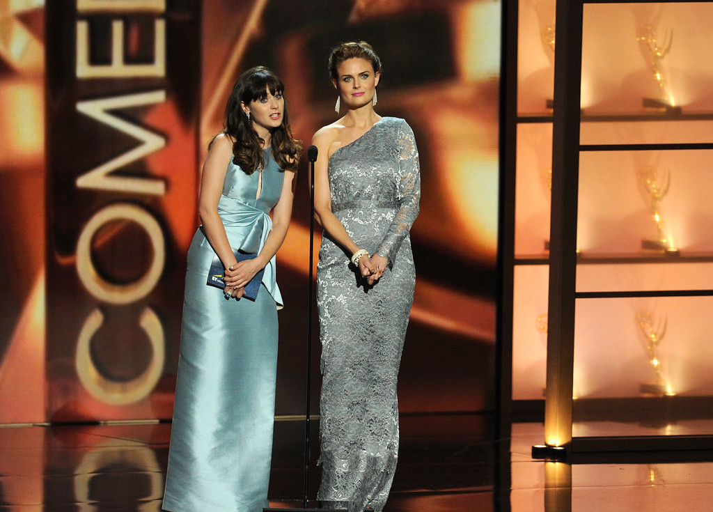 . Actresses Zooey Deschanel and Emily Deschanel speak onstage during the 65th Annual Primetime Emmy Awards held at Nokia Theatre L.A. Live on September 22, 2013 in Los Angeles, California.  (Photo by Kevin Winter/Getty Images)