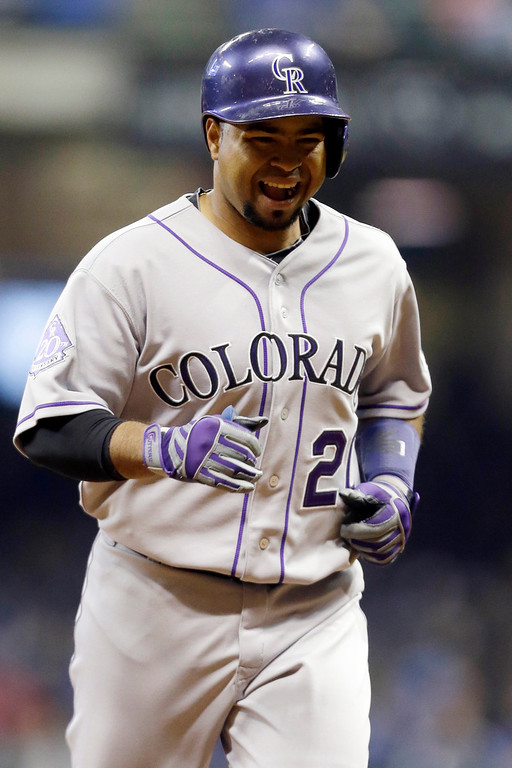 . Colorado Rockies\' Wilin Rosario reacts after his two-run home run against the Milwaukee Brewers during the second inning of a baseball game, Wednesday, April 3, 2013, in Milwaukee. (AP Photo/Jeffrey Phelps)