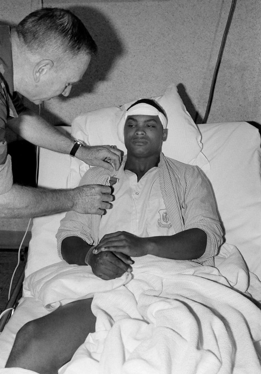 . In this Oct. 25, 1983, file photo, U.S. Marine Lovelle Moore from East St. Louis, Illinois, wounded in a truck bomb attack on his barracks in Beirut, is awarded the Purple Heart by U.S. Marines Corps Commandant Paul Kelley at the Wiesbaden Air Force hospital in Germany. The blast _ the single deadliest attack on U.S. forces abroad since World War II _ claimed the lives of 241 American service members. (AP Photo/Udo Weitz, File)