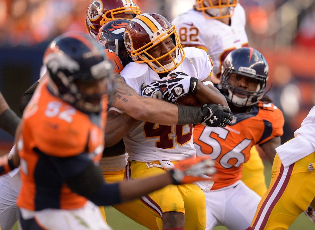 . Washington Redskins running back Alfred Morris (46) is tackled in the third quarter against the Denver Broncos. (Photo by John Leyba/The Denver Post)
