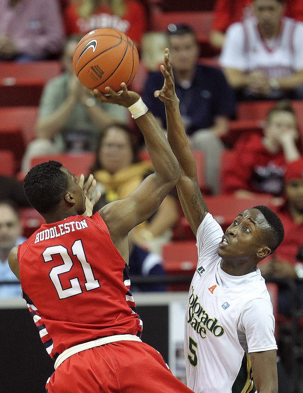 . Fresno State\'s Allen Huddleston shoots over Colorado State\'s Jonathan Octeus during the second half of a Mountain West Conference tournament NCAA college basketball game on Wednesday, March 13, 2013, in Las Vegas. Colorado State defeated Fresno State 67-61. (AP Photo/Isaac Brekken)