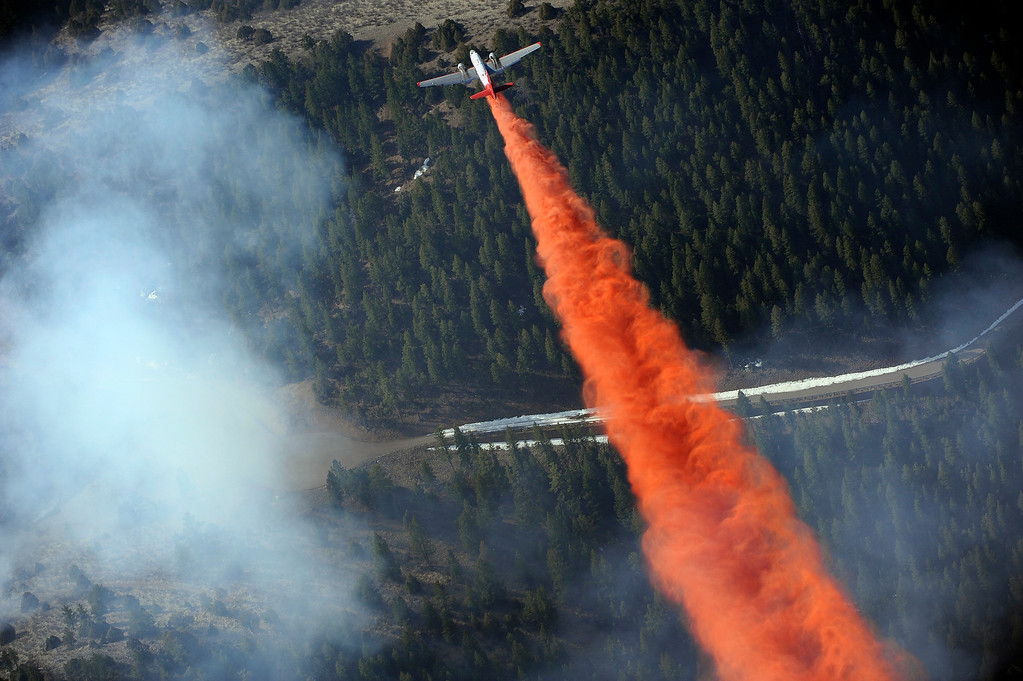 . A tanker drops slurry over the burn area of the Lower North Fork Wildfire near Denver, Colorado on Tuesday, March 27, 2012. Joe Amon, The Denver Post
