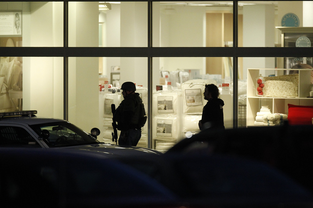 . Law enforcement personnel work the scene of a shooting at the Clackamas Town Center in Clackamas, Ore. Tuesday, Dec. 11, 2012. A gunman opened fire at the Portland, Ore., area shopping mall Tuesday, killing at least one person and wounding an unknown number of others, sheriff\'s deputies said. (AP Photo/The Oregonian, Bruce Ely)