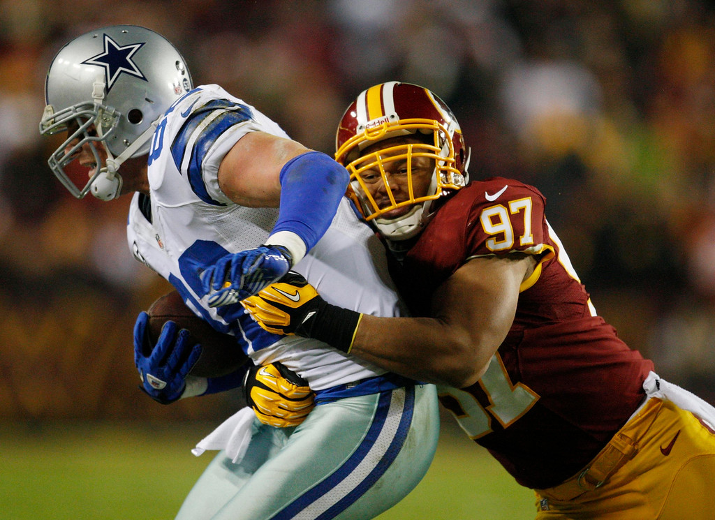 . Dallas Cowboys tight end Jason Witten (82) is ridden out of bounds by Washington Redskins linebacker Lorenzo Alexander (97) after a catch during the first half of their NFL football game in Landover, Maryland, December 30, 2012. REUTERS/Jonathan Ernst