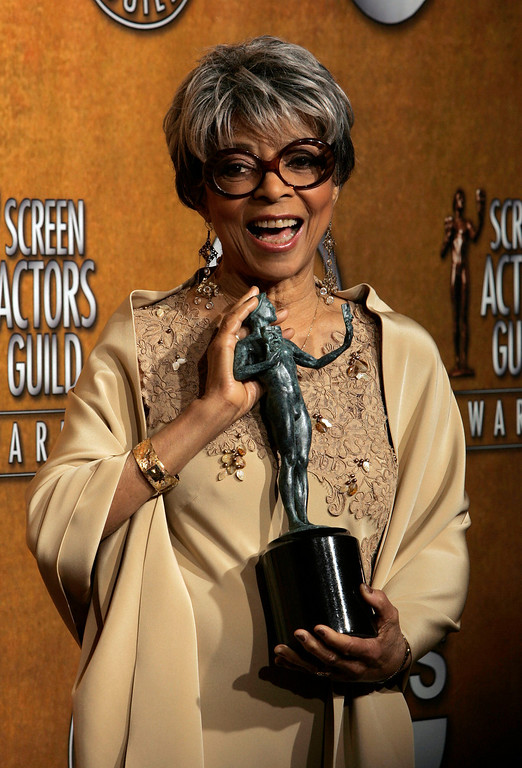 """. In this Jan. 27, 2008 file photo, Ruby Dee poses with the award for outstanding performance by a female actor in a supporting role for her work in \""""American Gangster\"""" at the 14th Annual Screen Actors Guild Awards, in Los Angeles.   (AP Photo/Reed Saxon, file)"""