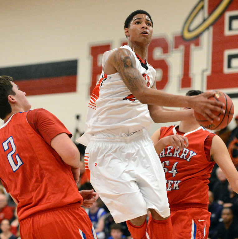 . East\'s Jevon Griffin, center, drives the ball against Cherry Creek\'s Griffin Parr, left, and Dylan Schneider in the 1st half of the game at East High School on Friday, Nov. 30, 2012. Hyoung Chang, The Denver Post