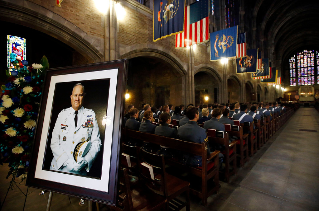 . A portrait of the late U.S. Four Star General H. Norman Schwarzkopf sits at the entrance to the Cadet Chapel as cadets from the First Regiment A-Company sit in attendance at his funeral service at the United States Military Academy at West Point, New York, February 28, 2013. REUTERS/Mike Segar