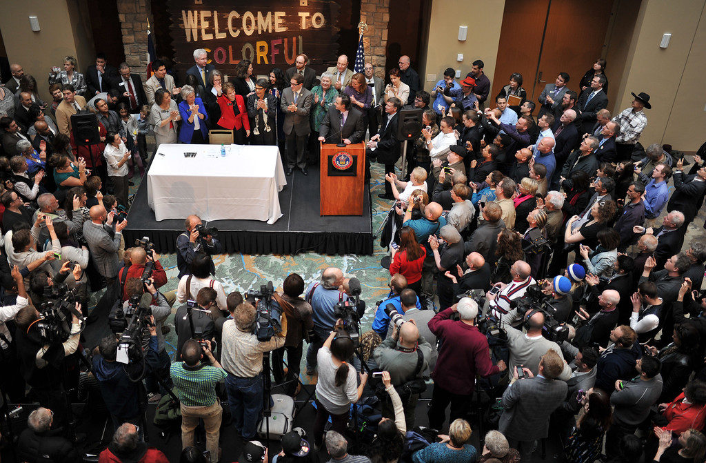 . DENVER, CO. - MARCH 21: Crowds packed History Colorado Center on Thursday to watch as Colorado Gov. John Hickenlooper signed Senate Bill 11 legalizing civil unions. Denver, Colorado. March 21, 2013. (Photo By Hyoung Chang/The Denver Post)