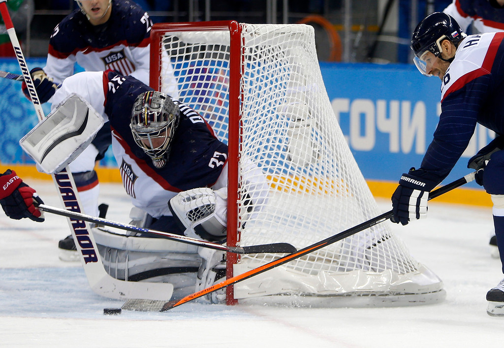 . USA goalkeeper Jonathan Quick (32) blocks a shot against Slovakia\'s Michal Handzus (26) in the third period for their preliminary round at the Shayba Arena for the 2014 Winter Olympics in Sochi, Russia on Thursday, Feb. 13, 2014.  (Nhat V. Meyer/Bay Area News Group)
