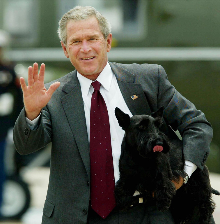 . President Bush  carries his dog Barney as he departs TSTC Airport Thursday, July 29, 2004 in Waco, Texas. Bush is leaving his Texas ranch after a weeklong working vacation. He kept a low profile while Democrats had their national convention.  (AP Photo/Pablo Martinez Monsivais)