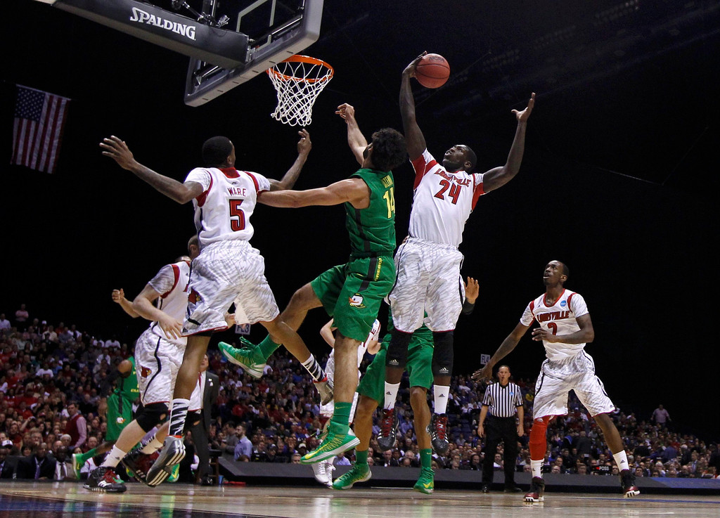 . Louisville Cardinals forward Montrezl Harrell (24) pulls down an rebound against Oregon Ducks forward Arsalan Kazemi during their Midwest Regional NCAA men\'s basketball game in Indianapolis, Indiana, March 29, 2013. REUTERS/Matt Sullivan