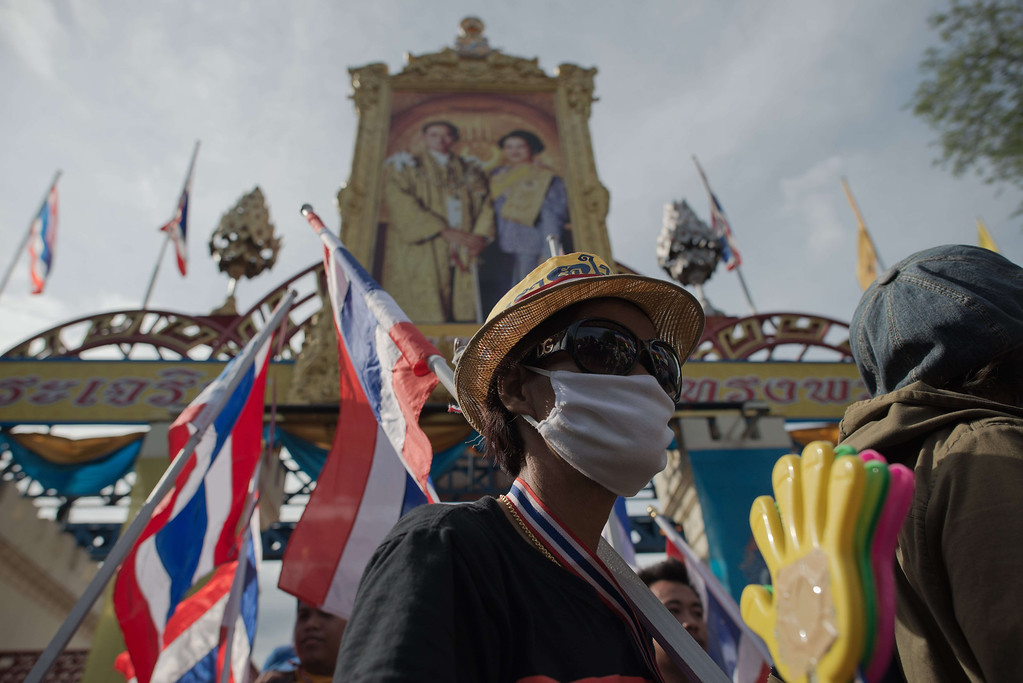 . Anti-government protestors leave the army headquarters after the stormed the building during a protest in Bangkok on November 29, 2013.  AFP PHOTO/ Nicolas ASFOURI/AFP/Getty Images