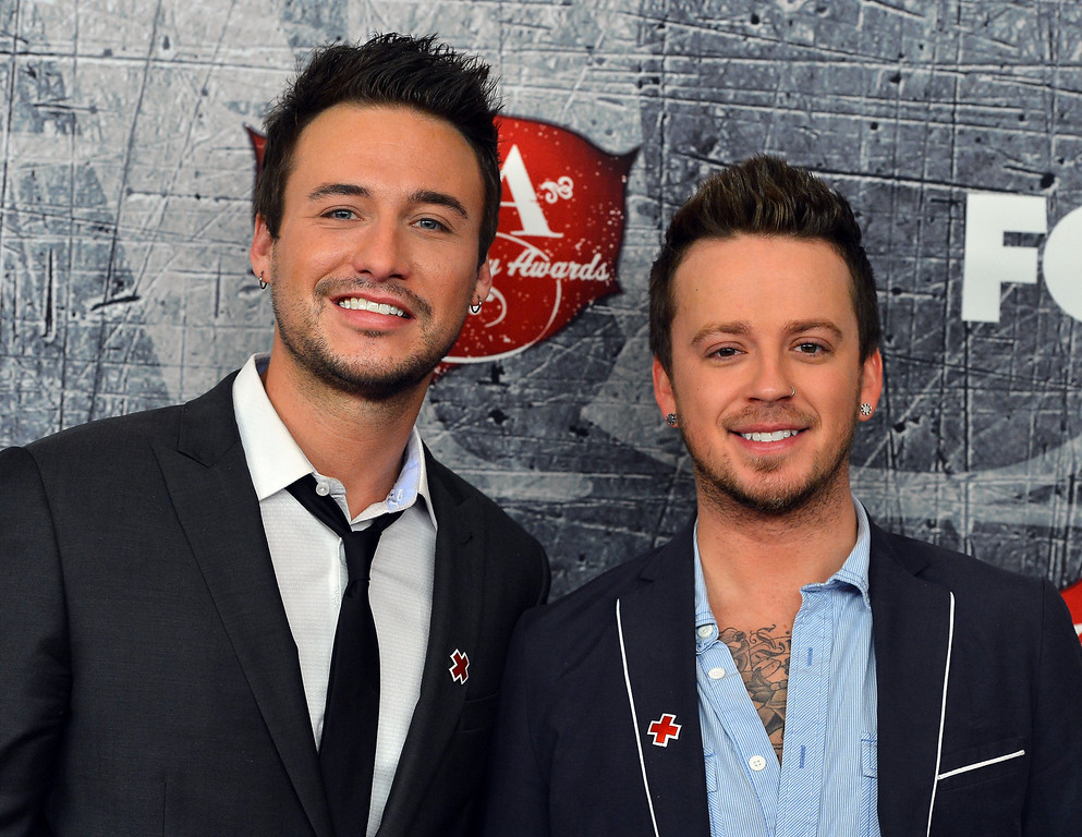 . LAS VEGAS, NV - DECEMBER 10:  Stephen Barker (L) and Eric Gunderson of Love and Theft arrive at the 2012 American Country Awards at the Mandalay Bay Events Center on December 10, 2012 in Las Vegas, Nevada.  (Photo by Frazer Harrison/Getty Images)