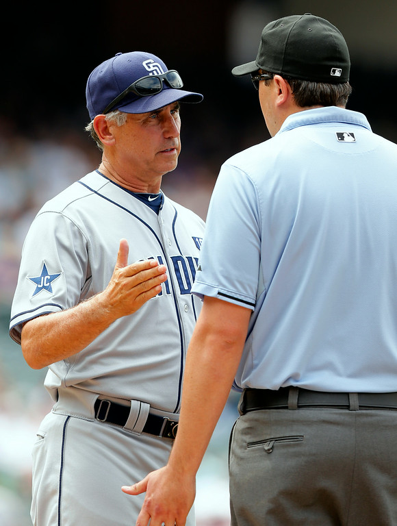. San Diego Padres manager Bud Black argues a foul ball call on Yasmani Grandal with first base umpire Lance Barrett during the fifth inning of a baseball game against the Colorado Rockies on Wednesday, July 9, 2014, in Denver. (AP Photo/Jack Dempsey)