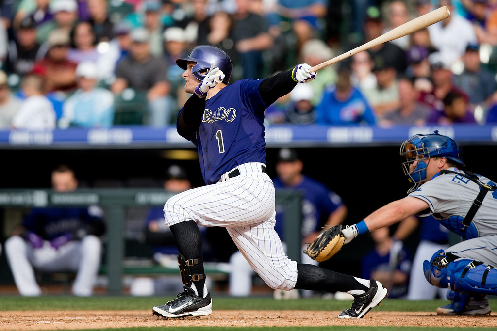 . DENVER, CO - JUNE 7:  Brandon Barnes #1 of the Colorado Rockies is watches his game winning RBI triple in the 10th inning to defeat the Los Angeles Dodgers 5-4 at Coors Field on June 7, 2014 in Denver, Colorado. The Rockies defeated the Dodgers 5-4 in 10 innings to end their eight game losing streak. (Photo by Justin Edmonds/Getty Images)