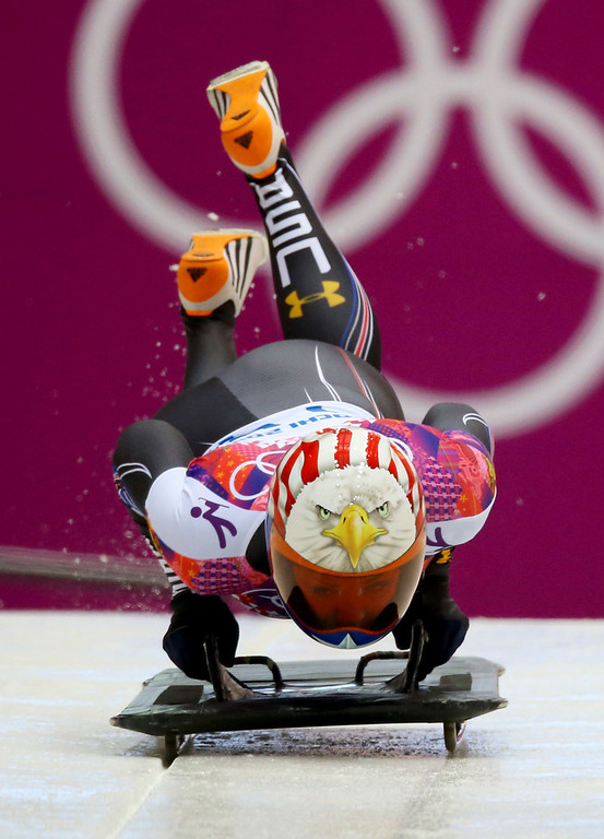 . Katie Uhlaender of the United States makes a run during the Women\'s Skeleton heats on Day 6 of the Sochi 2014 Winter Olympics at Sliding Center Sanki on February 13, 2014 in Sochi, Russia.  (Photo by Doug Pensinger/Getty Images)