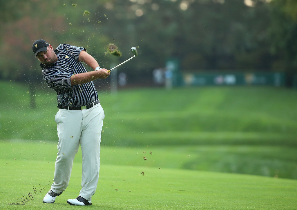 . DUBLIN, OH - OCTOBER 04:  Brendon de Jonge of Zimbabwe and the International Team hits his approach shot on the 13th hole during the Day Two Foursome Matches at the Muirfield Village Golf Club on October 4, 2013  in Dublin, Ohio.  (Photo by Andy Lyons/Getty Images)