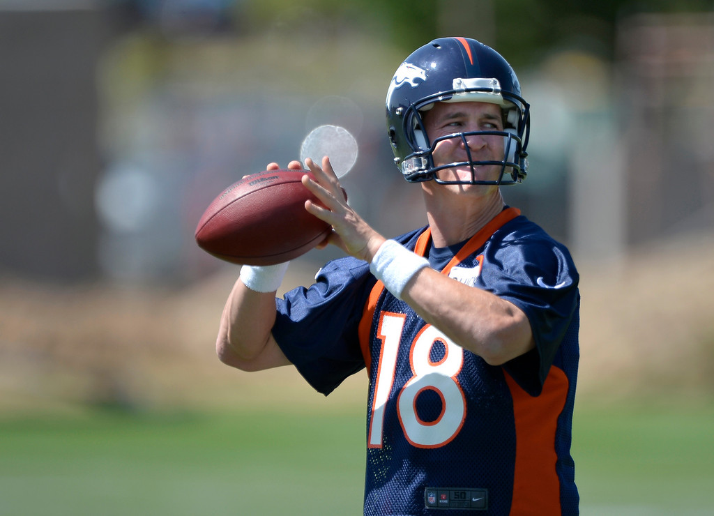 . Denver Broncos Peyton Manning (18) throws a pass during OTAs June 10, 2014 at Dove Valley. (Photo by John Leyba/The Denver Post)