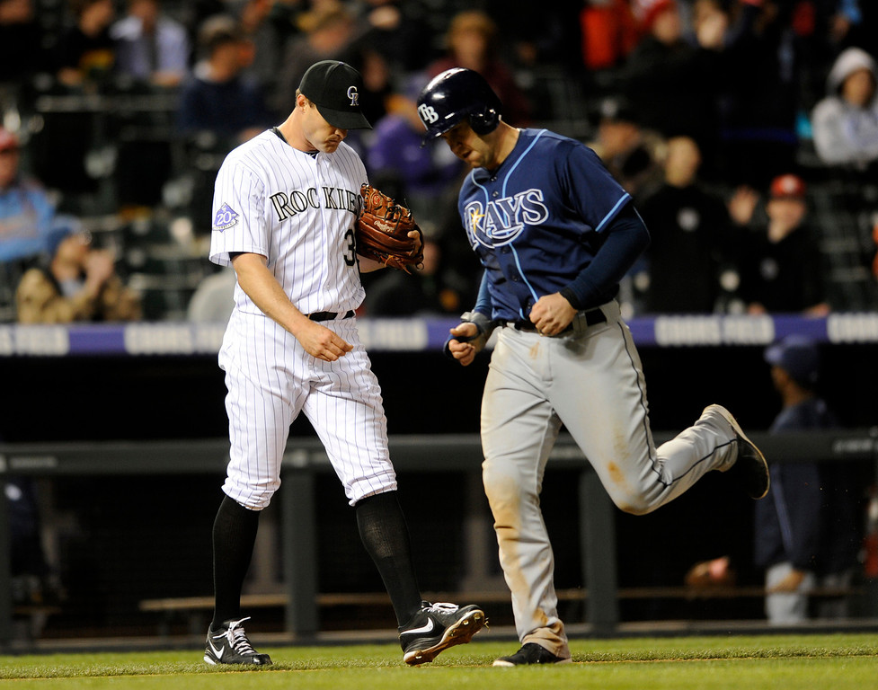 . Colorado Rockies relief pitcher Matt Belisle (34) hangs his head after giving up a two-run home run to Tampa Bay Rays\' Kelly Johnson during the tenth inning of a baseball game on Friday, May 3, 2013, in Denver. (AP Photo/Jack Dempsey)