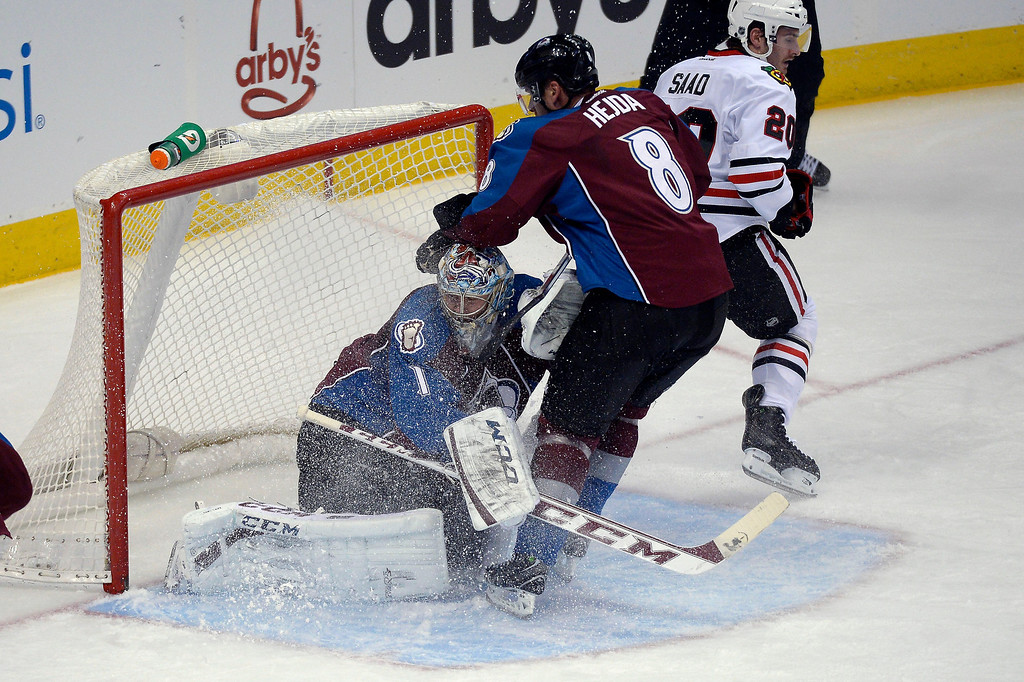 . CColorado Avalanche defenseman Jan Hejda (8) puts the breaks on before running in to Colorado Avalanche goalie Semyon Varlamov (1) during the second period against the Chicago Blackhawks November 19, 2013 at Pepsi Center. (Photo by John Leyba/The Denver Post)