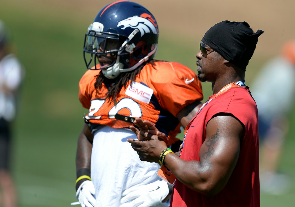 . Denver Broncos strong safety David Bruton (30) and Brian Dawkins look on during drills at the Denver Broncos 2014 training camp August 11, 2014 at Dove Valley. (Photo by John Leyba/The Denver Post)